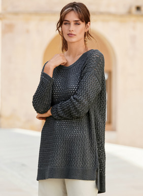 A chic tunic for languid days or thrown over a swimsuit come summer, our oversized pullover is knit in a lacy mesh cable of pima (51%) and modal (49%). An effortless layer over tanks and tees, with drop shoulders, jersey edge seaming, side slits and a ribbed hem that steps longer in back.