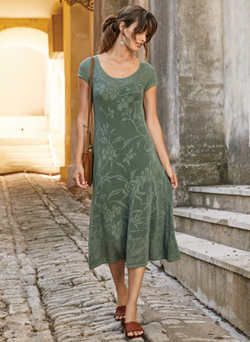 Inspired by a remnant of antique broderie anglaise, vining florals create tone on tone patterning on this pointelle lace knit dress. In pima (51%) and modal (49%), the fit-and-flare silhouette is styled with a scoop neck, short sleeves and a twirlable hemline.