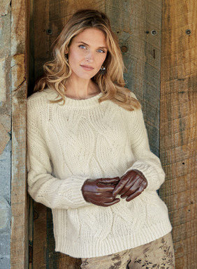 Cables are supersized on our soft fluffy pullover in Ivory baby alpaca. The fit is easy, with drop shoulders and a chunky rib trim.