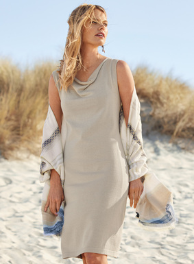 At once simple and sophisticated, our sleeveless shift is fine gauge knit of pima crepe yarns for an exquisite drape. The body-skimming silhouette is minimally styled with a draping neckline  and contoured shoulders.