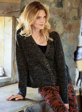 Knit of lofty pima (88%) and nylon (12%) bouclé yarns in tweeded black and brown, our snuggly cardigan is cropped and boxy, with a deep v-neck, drop shoulders and patch pockets. Delightfully cozy–and perfect over skinny jeans and skirts alike.