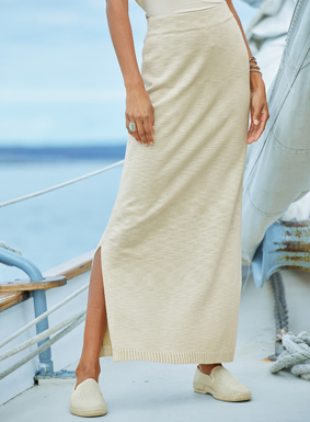 Casually chic the long column skirt is finished with deep side slits and ribbed trim.  Evokes a getaway vibe when paired with matching hooded tunic.