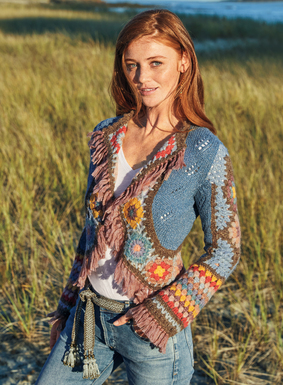 Bringing whimsy to warming days, our bolero is a bohemian fantasy of pointelle stitching, handcrocheted stripes and bright floral medallions. Handknit of soft baby alpaca (39%), pima (31%), polyamide (23%), wool (4%) and silver metallic threads (3%) for a dash of shimmer. Lavished with fringe at the placket, cuffs and petite peplum hem; single button-and-loop closure.
