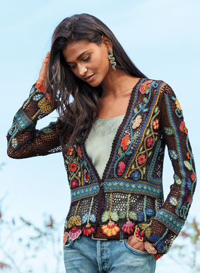 Folkloric blooms in rose, mango, olive, teal and sky vine up the aubergine netting of this exquisite, work-of-art, pima cardigan. Superbly crocheted by hand with a deep v-neck and banded waist, stemmed wildflowers form beautiful scalloping at the peplum hem and cuffs. Single button closure.