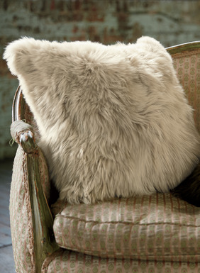 Over-the-top opulence for hearth and home, a plush suri alpaca fur pillow. An inspired gift for one and all, with a woven alpaca backing, cushion insert and zipper closure.