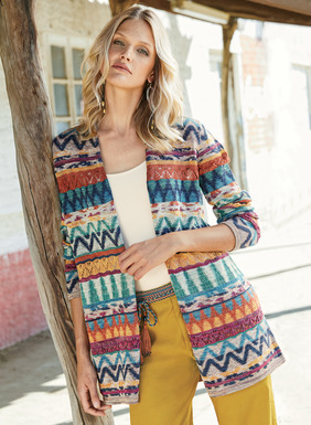 Painterly zigzags and pointelle openwork create colorful pattern and texture play on our pima cardigan. Knit in cheerful, tweeded brights–from cool turquoise to gold, orange and berry–and minimally styled with a rolled buttonless placket.