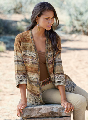 Fair Isle geometrics and banded striations span our cardigan in a palette of earthy desert hues. Knit of tweeded pima (80%), baby alpaca (14%) and wool (6%) yarns, with a relaxed fit, drop shoulders, ¾-sleeves, side slits and an open placket.