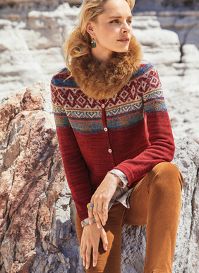 Our cheery Fair Isle cardigan is yoked in Scandinavian patterning on a striated cherry-red ground. In snuggly soft pima (42%), baby alpaca (40%), wool (16%) and nylon (2%).