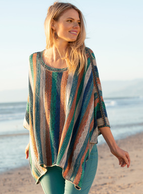 The breezy, poncho-style pullover is striped in tweeds of terra cotta, teal, dusk blue and birch pima. Edged in fine, handcrocheted trim, the eased, oversized silhouette features tacked armholes and deep side slits.