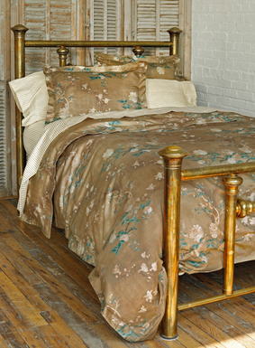 We've reinterpreted one of our signature prints as a luxurious collection for the bed. Flowering magnolia blossoms from a Chinese embroidery wash across a luminous gold ground of silky cotton sateen; mother-of-pearl button closures. Duvet cover set includes a duvet cover and two shams (standard shams for Full/Queen set; king shams for King set).