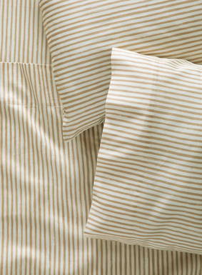 Hand-painted watercolor stripes of golden tan on ivory are perfectly imperfect as they wash across smooth, 200-thread-count cotton sateen. Sheet set includes a flat sheet, fitted sheet and two pillowcases (standard cases for Queen set; king cases for King and California King sets).