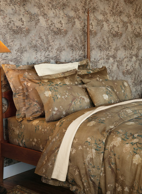 We've reinterpreted one of our signature prints as a luxurious collection for the bed. Flowering magnolia blossoms from a Chinese embroidery wash across a luminous gold ground of 200-thread-count cotton sateen. Included are two pillowcases, either in standard size or king size. (Other bedding items sold separately.)