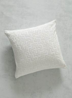 Intricate ivory rice stitching creates a maze of embroidered patterning on our textural ivory cotton pillow. Equally at home in contemporary and more traditional decors, it's a gorgeous way to add tonal pattern to the bed or sofa; zip closure.