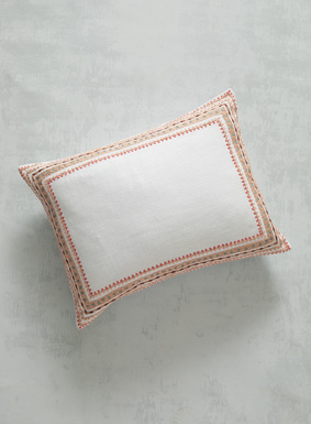 Rows of mixed rice stitching form an ornate border treatment on our pillow in fresh hues of pink, peach, taupe and sky. A lovely way to add a splash of color to the bed, it's sewn of textural ivory cotton; zip back closure.