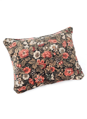 Dramatically set against a black ground, flowers and butterflies pattern our pillow in coral, rose, cream and olive. Patterned after our founder's Victorian wallpaper, in plush polyester velvet, with velvet cording, a solid walnut-hued back and zip closure.