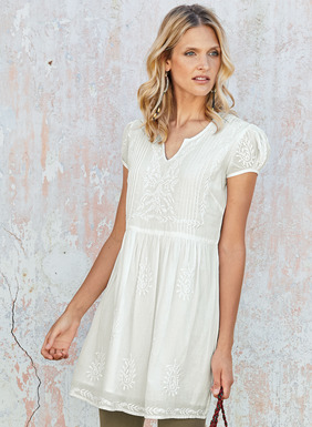 Pintucks are embroidered in white paisleys on this floaty white tunic of weightless cotton voile. Designed with a split v-neck and easy A-line shape to look great over skinny trousers or cropped leggings. Fully lined so you can wear it as a mini.