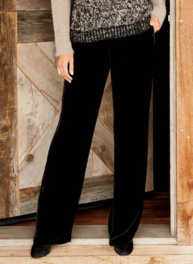 Effortlessly elegant, the drapy, wide-leg trousers of lush black velvet have a banded waist, side pockets and zipper. Rayon (82%) and silk (18%).