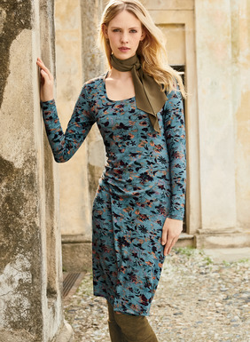 Shadowy leaves and flowers drift across the azure field of this versatile jersey dress. Sewn of rayon (95%) and spandex (5%), it flatters with a scoop neck, slim sleeves, delicate waist gathers and a drapy faux wrap panel.