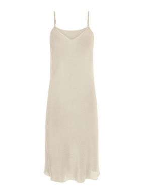 The indispensable Silk Slip Dress has a v-neck and adjustable straps for luxurious layering.