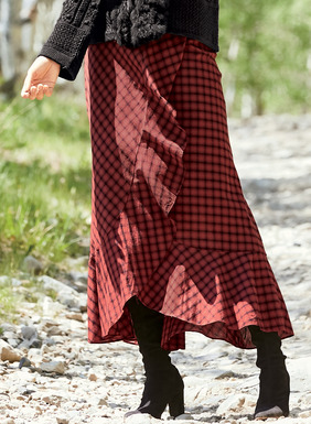 For highland forays or urban adventures, the homespun wrap skirt is sewn from a rust and black plaid, cut on the bias for a flattering fit. Styled with an asymmetrical ruffle that cascades to a full hem for dramatic movement; hook/bar and snap closure. Cotton (51%) and viscose (49%).