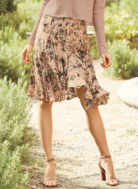 Sprays of vintage roses wash across the blush ground of our feminine, drapy skirt. Sewn of lightweight viscose (89%) and silk (11%), it's shaped through the waist and hips, with curved seaming, a circular flounce and a hem that curves up slightly in front.