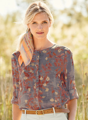 Our breezy, band-collared blouse in rayon (62%) and modal (38%) is dappled in floral brushstrokes on Dusk or Peach (modeled). Hidden button placket; back pleat; flowy sleeves; deep cuffs; shirttail hem.