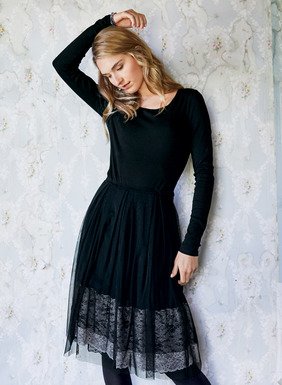 Sophisticated one-and-done dressing. The fit-and-flare dress is constructed with a ribbed cotton (92%) and elastane (8%) bodice and a gossamer nylon netting skirt. The sheer skirt veils a cream and black lace with jersey underlayer.