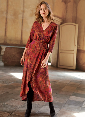 Awash in paisleys, our consummately flatter-ing wrap dress in drapy rayon (62%) and modal (38%) is cast in opulent hues of ochre, paprika, persimmon, violet and olive. Styled with a side tie, ¾-sleeves and floaty curved hem.