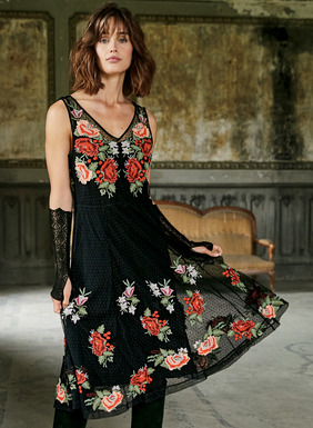 Inspired by a vintage Bolivian dance costume, this sensational dress in sheer black Swiss dot nylon netting is lavishly embroidered with sprays of colorful roses.  Fitted through the bodice and flaring to a twirlable hem garlanded with flowers. Underneath, a black viscose (95%) and elastane (5%) jersey slip dress with adjustable spaghetti straps.