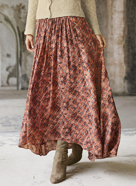 In a palette of rosy hues, faded blooms climb a diagonal plaid on our flowing maxi-skirt. Sewn of rayon (62%) and modal (38%), the fitted, contoured yoke releases in front gathers to a sweeping hem that dips longer in back.