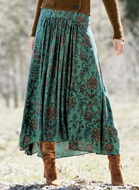 Delicate, hand-drawn Persian botanicals illustrate the weathered blue ground of the flowing maxi-skirt. Sewn of drapy rayon (62%) and modal (38%), the fitted, contoured yoke releases in front gathers to a sweeping, back-dipping hem.
