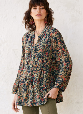 Effortlessly romantic, our tunic is strewn with delicate florals from an 18th century English textile. Sewn of drapy rayon (62%) and modal (38%) and finished with a banded collar, split v-neck and blouson sleeves. Pintucks at the front and back release into a full, flowy hem.