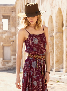 Hand-drawn Persian botanicals illustrate the wine-dark ground of the rayon (68%) and modal (32%) cami.  The fit-and-flare cami can be tucked in or left to float free. Scoop neck; adjustable spaghetti straps.