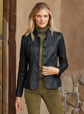 Our sleek military-style jacket is upgraded to luxury status in buttery soft black leather. Impeccably shaped and tailored with a convertible stand collar and crisply pleated back peplum.  Flap pockets; lined.