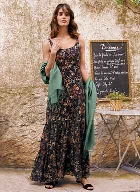 For date-nights or special occasions, our dramatic maxi-dress is patterned in sunset-hued florals on a ground of black viscose (95%) and elastane (5%) jersey. Detailed with a double-scoop neckline and built-in shelf bra, the fitted torso releases to a two-tiered woven viscose flounce for dramatic movement with every step.