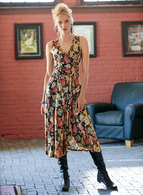 The sultry, tea-length dress is printed in wildflowers of red, mallard, indigo and cream on black on viscose (95%) and elastane (5%) jersey. Adding to the allure, a faux-wrap deep v-neck top that releases in pleats to a fluttering, angled hem.