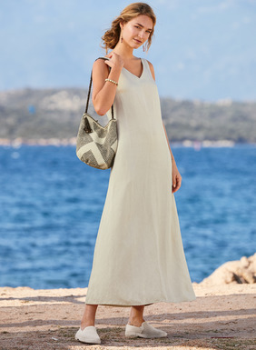 Fabulous day into evening, the Tencel® (64%) and linen (36%) tank dress is long and languid, with a double v-neck, pockets and an ankle-grazing A-line hem.