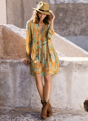 Sketched botanicals from an old Buddhist textile pattern the washed amber and verdigris ground of this whimsical dress. Sewn of breezy viscose, with a split v-neck and blouson sleeves. Pintucks narrow the bodice front and back and release to a floaty, pleated hem.