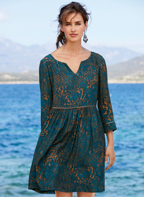 Spring's perfect day dress is effortless one-and-done dressing. Our free-spirited frock is stenciled with abstract florals in deep teal and ginger. Sewn of drapy viscose and accented with contrast piping, the floaty silhouette features a split v-neck, ¾-sleeves and a raised waist that releases to a gathered skirt with pockets.