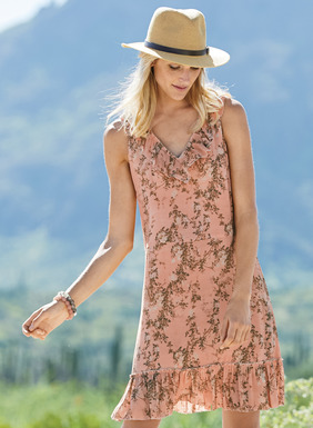 Branches from an ancient Chinese scroll pattern the blush-hued ground of this romantic shift dress. Skimming the body in drapy rayon (62%) and modal (38%), a ruffle-trimmed v-neck, seamed waist and flounced hem add feminine flourish.