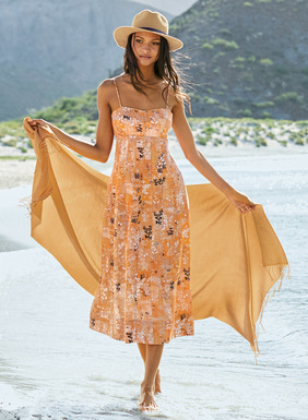 The season's most appealing sundress is sketched in delicate botanicals on a sun-faded field of mango and blush. Tailored in soft, lightweight Tencel®, the lingerie-inspired silhouette has adjustable spaghetti straps, a lined bustier and a fitted torso topping a skirt that flares to an A-line shape; pockets.