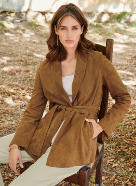 Quintessential sophistication: our luxe wrap jacket in buttery-soft, goat suede is an investment you'll treasure for a lifetime. Lined in our signature print and superbly finished with a shawl collar, princess seaming, defined waist, back pleats, side seam pockets and matching belt. Single hook-and-eye closure.