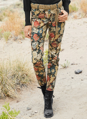 In smooth, stretchy sateen, the slim-fitting trousers are printed with a colorful vintage florals on black with classic 5-pocket styling in cotton (97%) and spandex (3%).