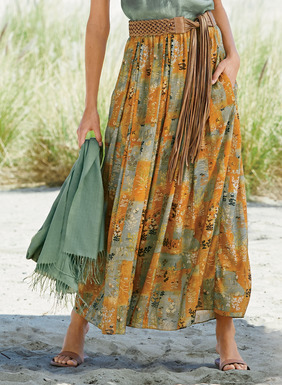 Pen and ink botanicals adorn a prayer flag backdrop, washed in tones of curry and verdigris, on our flowing maxi-skirt. Tailored of drapy rayon (62%) and modal (38%), with an exposed wide elastic waistband and pockets; lined.