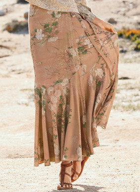Welcome spring in our graceful maxi-skirt. Pen-and-ink botanicals echoing an antique Japanese screen come to life in hues of sage, cream and sand on dusty peach. The wrap silhouette in viscose (98%) and elastane (2%) has a soft A-line shape, long side tie and curved seaming, flaring at the knee to a flounced hem.