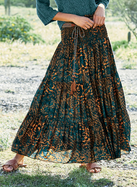 Stenciled Japanese florals pattern our free-spirited maxi-skirt in deep teal, indigo and ginger. Sewn of drapy viscose, it features a wide smocked yoke, and flows in three tiers to an ankle-grazing hem.