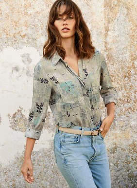Illustrated with pen-and-ink Asian botanicals on a wash of sky blue and sand, our drapy rayon (62%) and modal (38%) shirt is finished with a hidden button placket, pockets and shirttail hem.