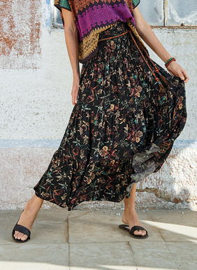 Stenciled botanicals  pattern the black viscose maxi-skirt. The slimming, smocked yoke flows in gathered tiers to an ankle-grazing A-line hem.