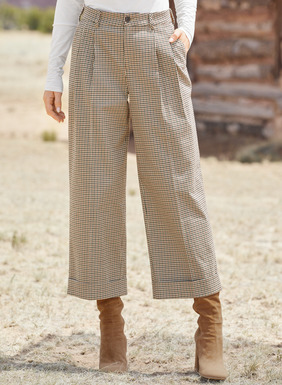 The menswear-inspired, wide-leg trousers are smartly tailored in an Italian microcheck of cotton (93%), wool (5%) and elastane (2%). Styled with front pleats, belt loops and cuffs. Front trouser pockets; back welt pockets; button/zip closure.