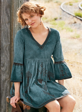 The silhouette of fall, our bohemian tunic-dress is crafted of pigment-dyed lyocell (60%)  and linen (40%) for a painterly, weathered look. The easy empire waist style is embellished with chocolate brown embroidery at the v-neck, belled ¾-sleeves, gathered skirt and A-line hem; pockets.